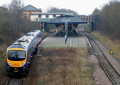 Atherton station on 14 Feb 2009, with a diverted Trans-Pennine Express creeping west toward Wigan.