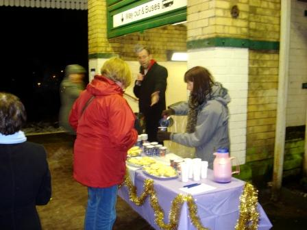 FOWS serve festive treats to passengers arriving at Walkden during the Meet The Manager session.
