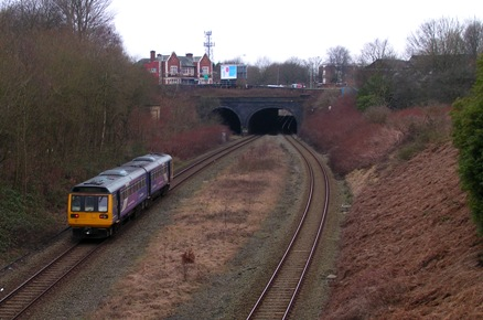 A Pacer passes the site of Pendlebury Station on the approach to Pendlebury Tunnel in Feb. 2009.
