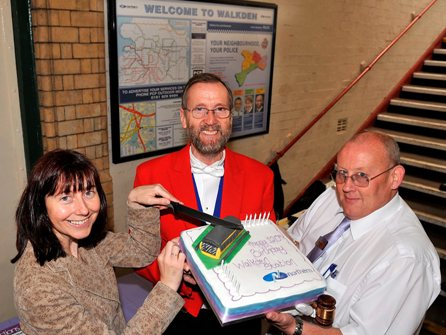 FOWS and Northern Rail's Station Manager cutting the 120th Birthday Cake - complete with Pacer topping !