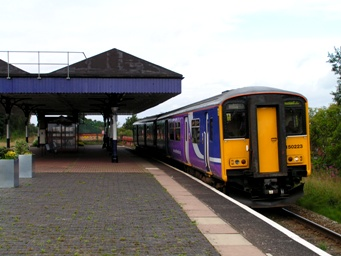 Class 150 train arriving at Walkden with a train for Manchester during summer 2008.
