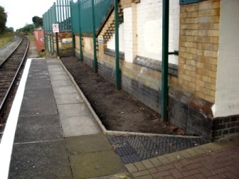 Disused area of Wigan platform before planting of a flower bed by FOWS