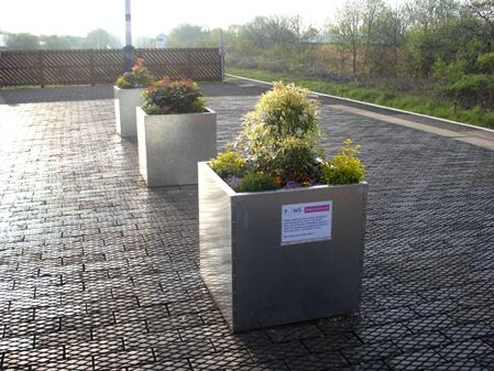 The steel planters installed by FOWS at the east end of the platform at Walkden.