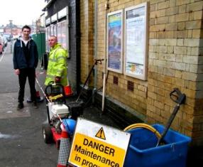 Members of the JetClean team outside Walkden station entrance.