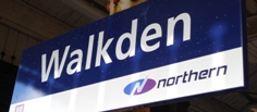 A platform sign at Walkden in Northern Rail colours.