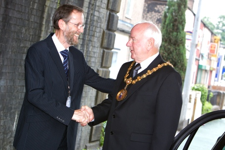 Peter Aust greets the Mayor of Salford.