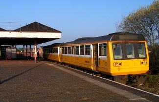 A Class 142 Pacer in Merseyrail yellow colours at Walkden on 4th August 2008.